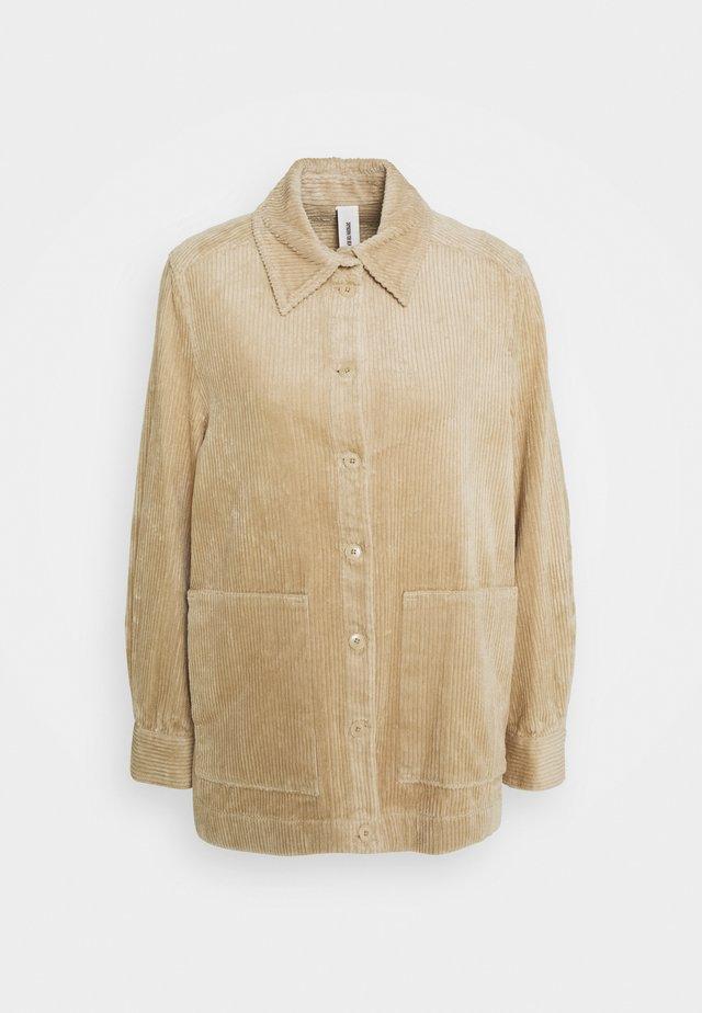LANDEN - Button-down blouse - braun