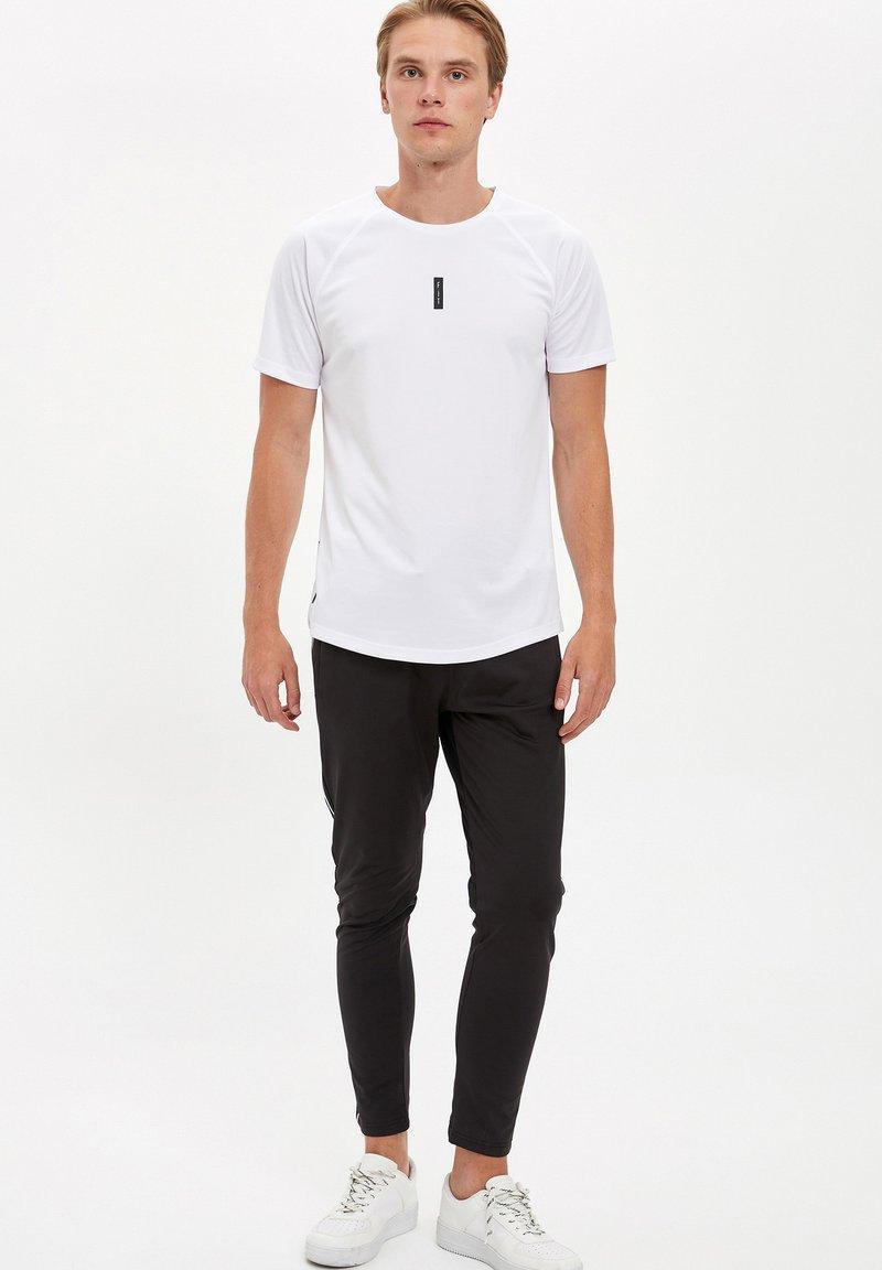 DeFacto Fit - Pantaloni sportivi - black
