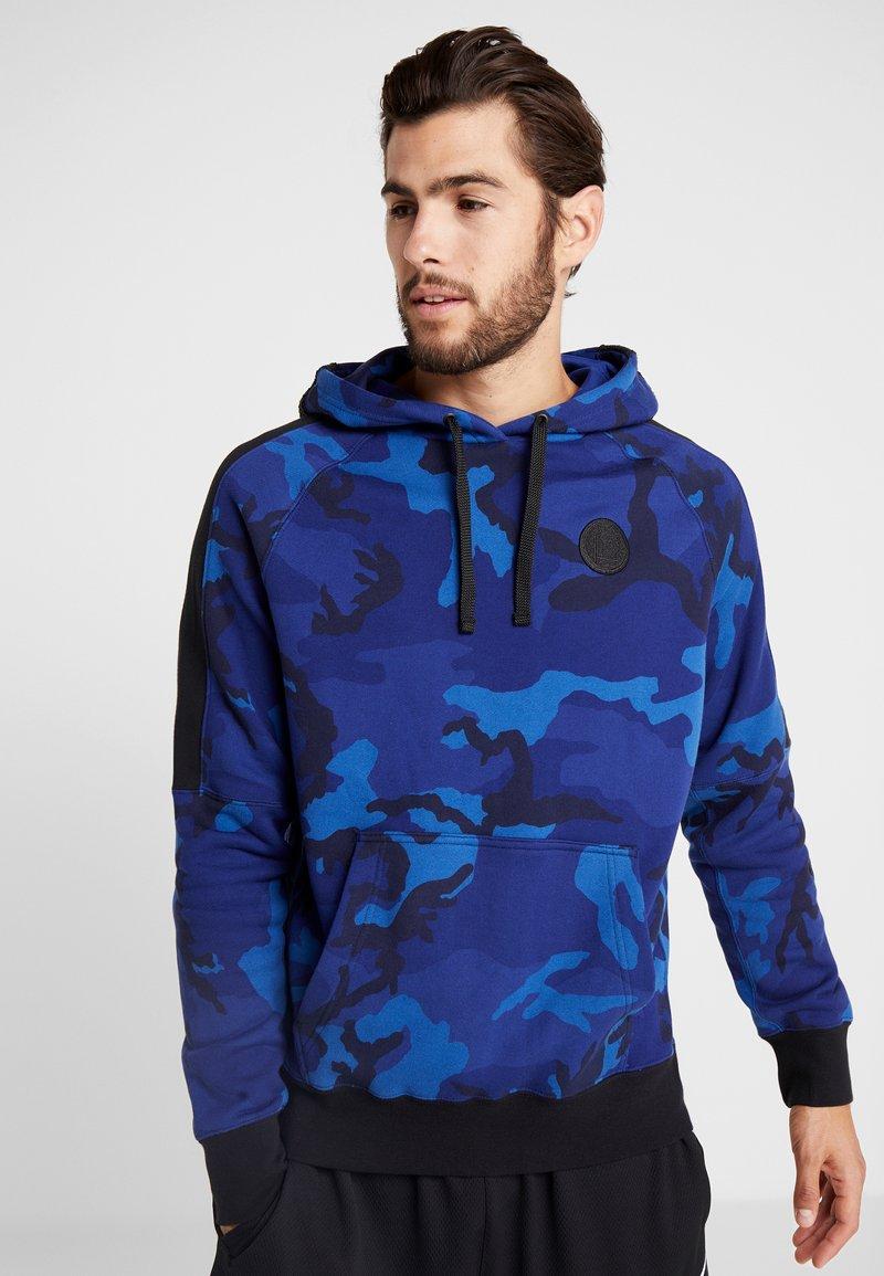 Nike Performance - NBA GOLDEN STATE WARRIORS CAMO HOODIE - Kapuzenpullover - rush blue/black