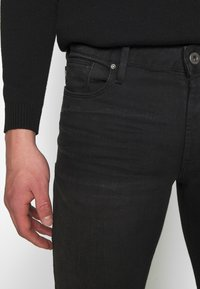 Emporio Armani - Slim fit jeans - denim nero