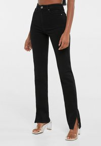 Bershka - SCHLITZ - Jeans straight leg - black - 1