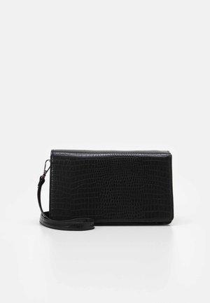 PCDEVON SHOULDER BAG  - Across body bag - black/silver