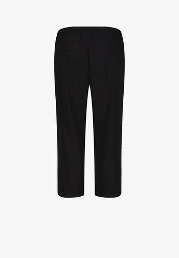 CHIARA  - Trousers - black