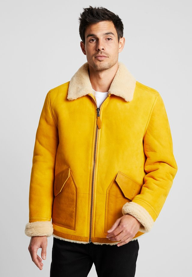 SEASONAL SHORT SHEARLING JACKET - Chaqueta de cuero - sunflower yellow
