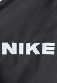 Nike Sportswear - CITY MADE PONCHO - Summer jacket - black/white - 2