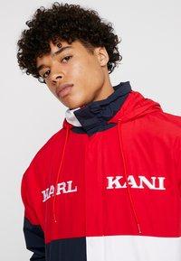 Karl Kani - RETRO BLOCK WINDBREAKER - Summer jacket - red/black/white - 6