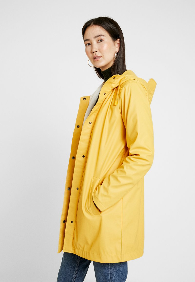 ONLY Tall - ONLVANESSA SHERPA RAINCOAT - Parkatakki - yolk yellow