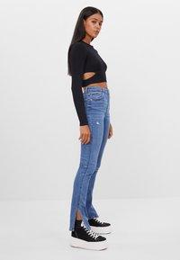 Bershka - Bootcut jeans - blue denim - 1