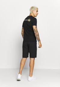 Calvin Klein - REGULAR FIT CRINKLE - Teplákové kalhoty - black - 2