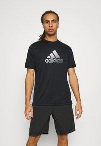 adidas Performance - Print T-shirt - black/gresix - 0