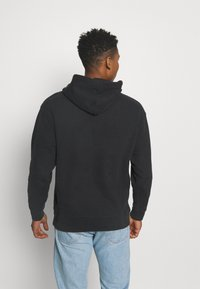Levi's® - RELAXED GRAPHIC - Hoodie - caviar - 2