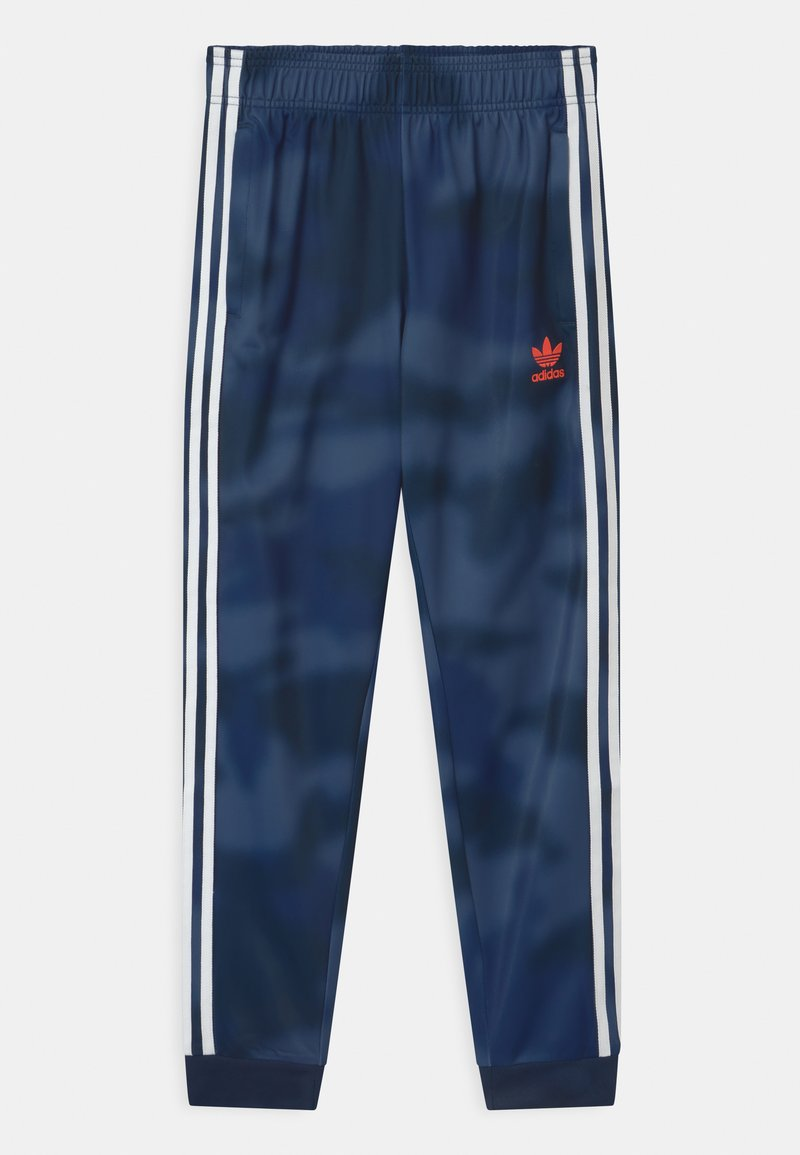 adidas Originals - CAMO SUPERSTAR UNISEX - Tracksuit bottoms - crew blue/white