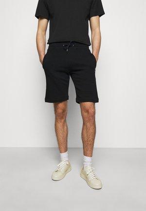 REGULAR FIT - Teplákové kalhoty - black