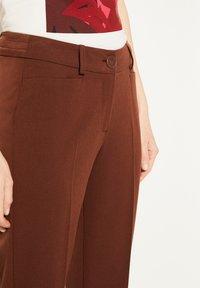 comma - REGULAR FIT - Trousers - dark red velvet - 4