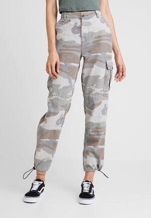 PALE CAMO FRIDA - Trousers - khaki