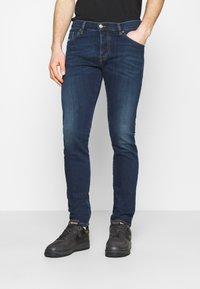 Diesel - YENNOX - Slim fit jeans - dark blue - 0