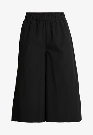 FASHION CROPS - Tracksuit bottoms - black/jet gray