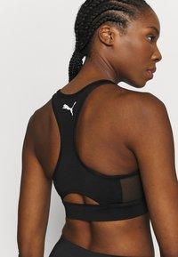 Puma - PAMELA  REIF X PUMA  COLLECTION LAYER SPORT CROP  - Medium support sports bra - black - 3