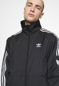 adidas Originals - UNISEX - Training jacket - black - 4