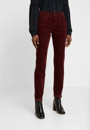 SKINNY - Trousers - tawny port
