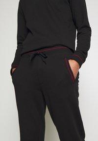 HUGO - DOAK - Teplákové kalhoty - black - 4