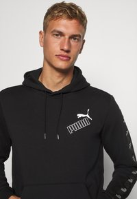 Puma - AMPLIFIED HOODIE - Sweat à capuche - black - 3