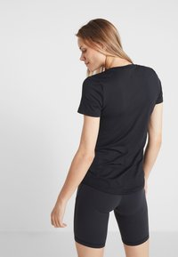 Reebok - TEE - T-Shirt basic - black - 2