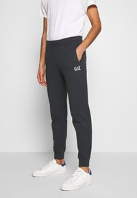 EA7 Emporio Armani - PANTALONI - Tracksuit bottoms - night blue - 0