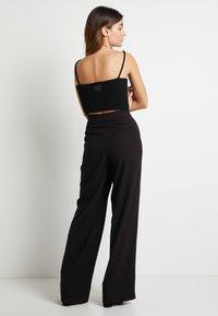 Pepe Jeans - DUA LIPA x PEPE JEANS - Trousers - black - 2