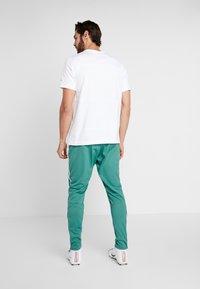 Nike Performance - DRY PANT  - Tracksuit bottoms - bicoastal/white - 2