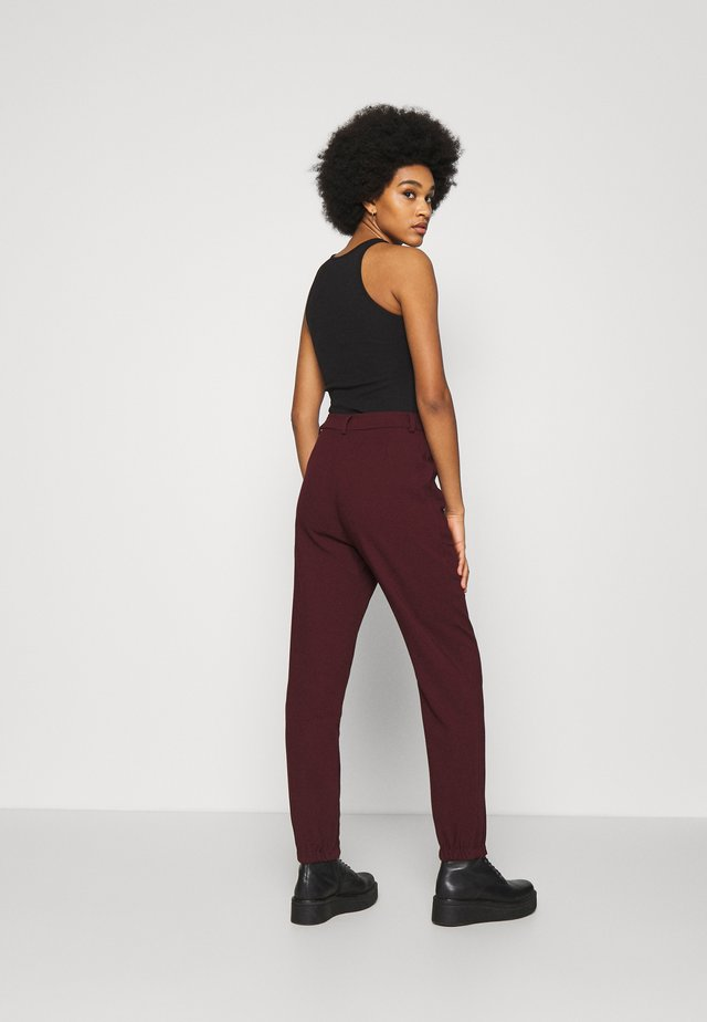 KASIA TROUSER - Tracksuit bottoms - wine red