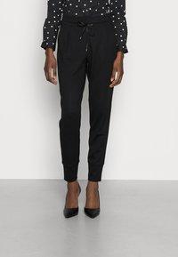 Opus - EMELA  - Trousers - black - 0
