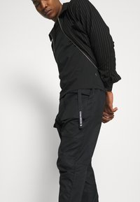 Converse - PANELED JOGGER - Cargo trousers - black - 3