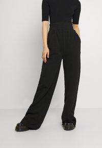KENDALL + KYLIE - K AND K FLARE HIGH RISE - Pantalones deportivos - black - 0