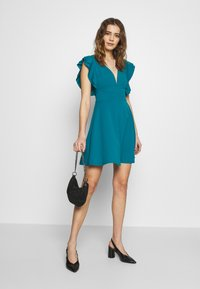 WAL G. - RUFFLE SLEEVE MINI DRESS - Cocktail dress / Party dress - teal - 1