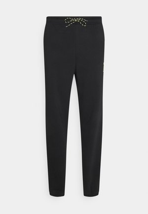 HELLY HANSEN PANTS - Verryttelyhousut - black