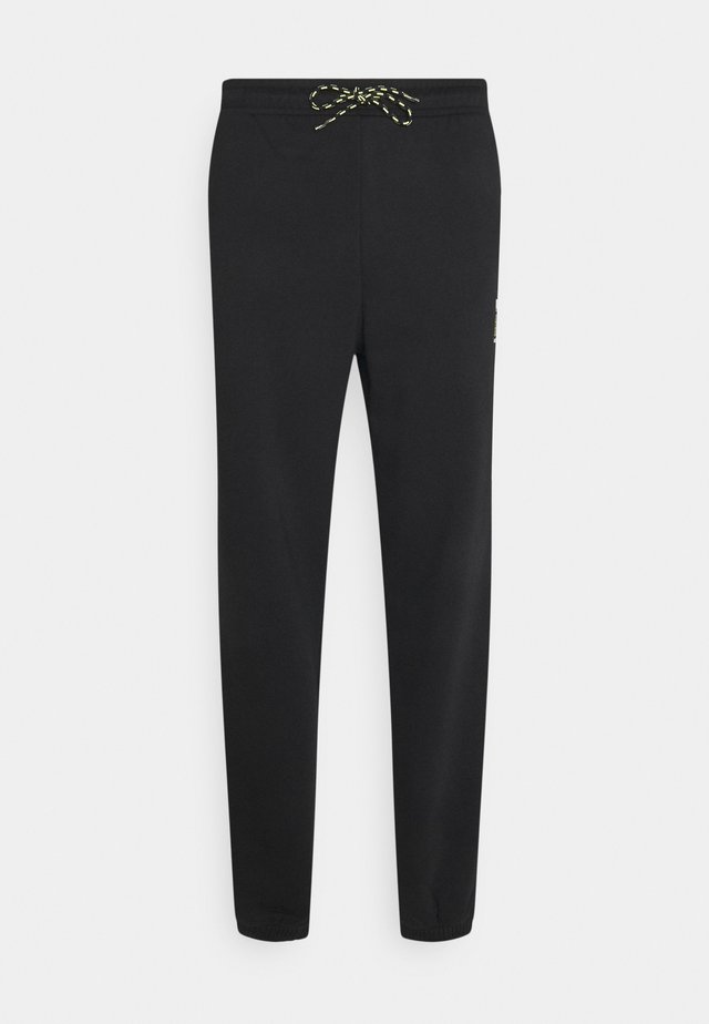 HELLY HANSEN PANTS - Pantaloni sportivi - black