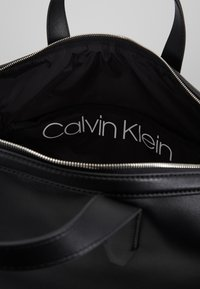 Calvin Klein - PUNCHED - Weekend bag - black - 4