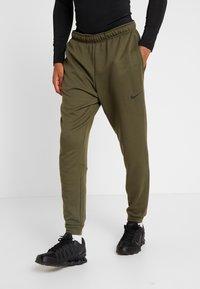 Nike Performance - DRY PANT TAPER - Tracksuit bottoms - cargo khaki/black - 0