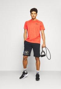 Under Armour - RIVAL LOCKERTAG SHORT - Sports shorts - black - 1