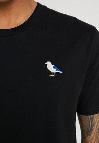 Cleptomanicx - EMBRO GULL - T-shirt - bas - black - 4