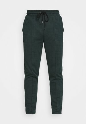 CHECK JOGGER - Tracksuit bottoms - green