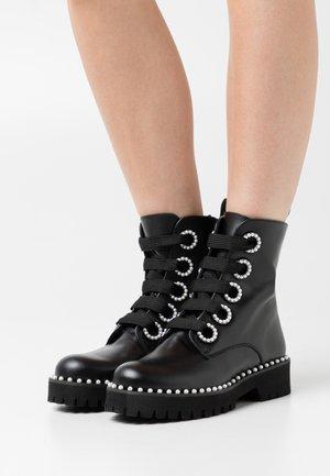 PURLA - Platform ankle boots - black