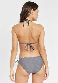 s.Oliver - Bikini top - black/white - 2