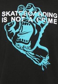 Santa Cruz - UNISEX CRIME HAND - Print T-shirt - black - 2