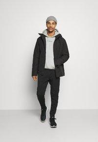 Vaude - MENS LIMFORD JACKET IV - Winter jacket - black - 1