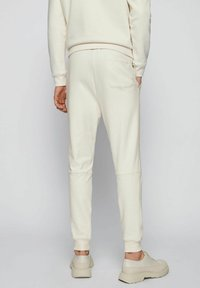 BOSS - Tracksuit bottoms - natural - 2