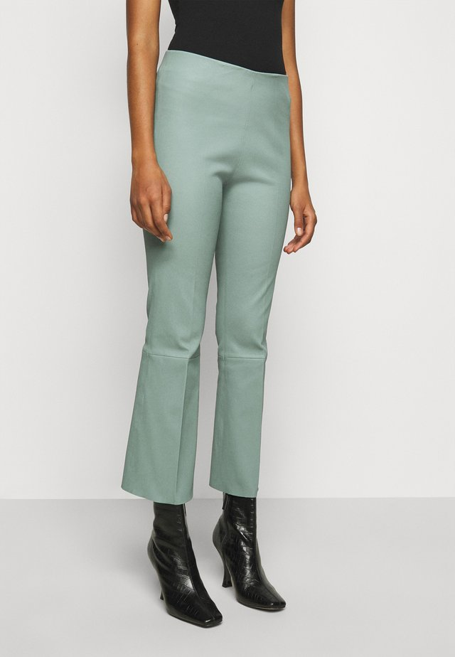 PHASE - Leather trousers - green