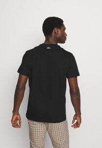 Lacoste - Print T-shirt - black - 2