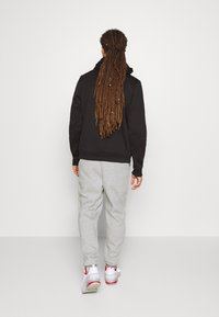 Tommy Hilfiger - CUFFED REGULAR PANT - Tracksuit bottoms - grey - 2